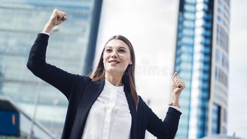 Successful business woman with arms up outdoors royalty free stock images