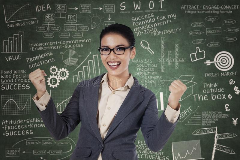 Successful business woman with arms up royalty free stock photography