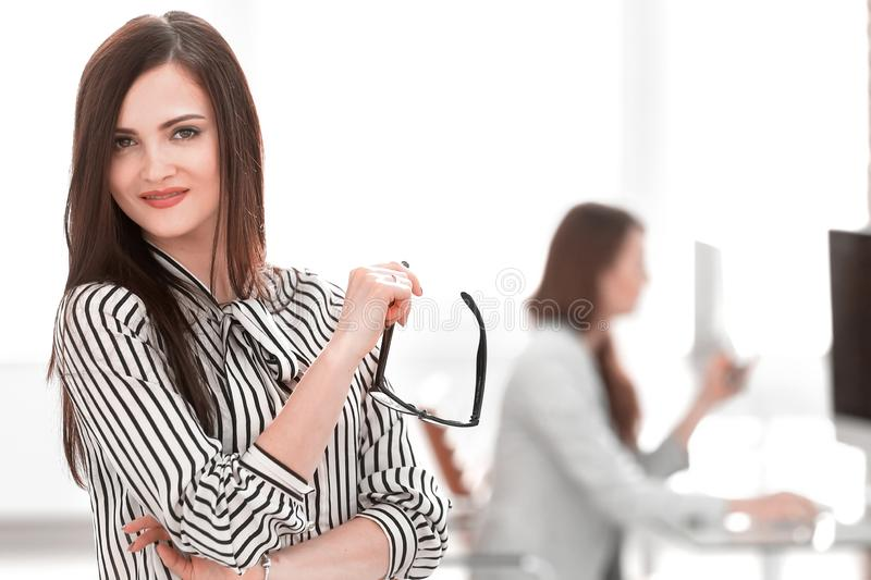 Successful business woman on the background of her office. Successful business women on the background of her office.photo with copy space royalty free stock image