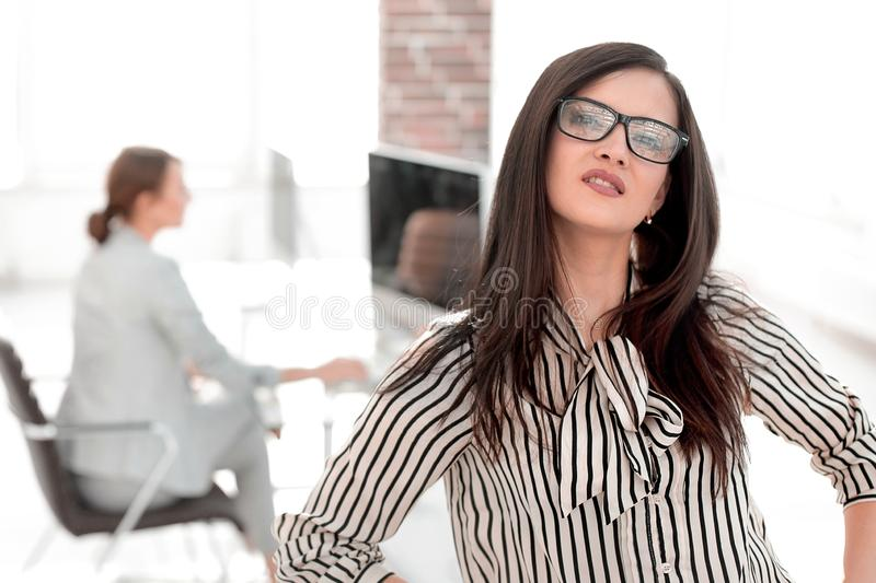 Successful business woman on blurred office background stock image