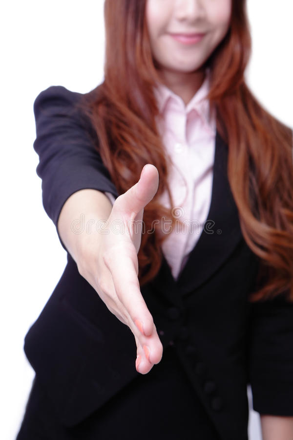 Successful business woman holds out her hand