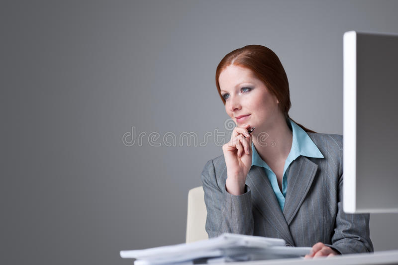 Successful Business Woman At Office Thinking Stock Photography
