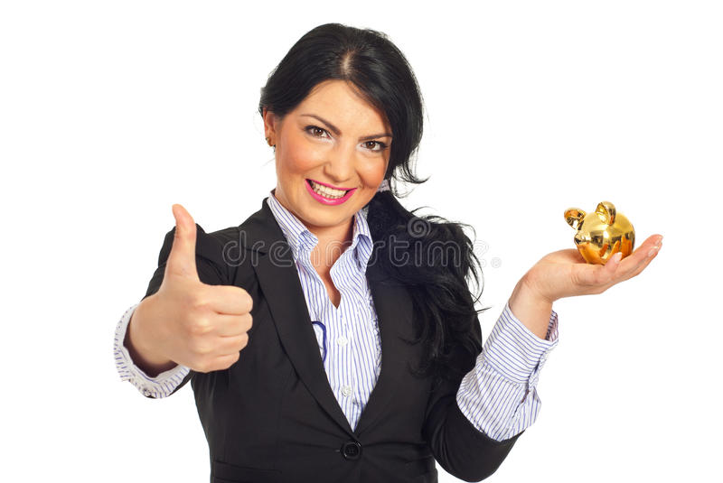 Successful business woman with piggy bank stock image
