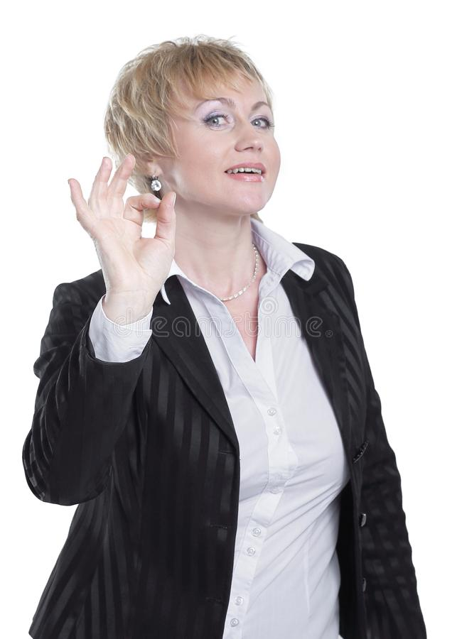 Successful business woman showing OK sign .isolated on white royalty free stock image
