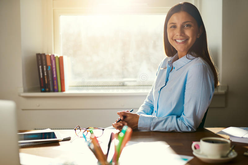 Successful business woman sitting at her desk royalty free stock photos