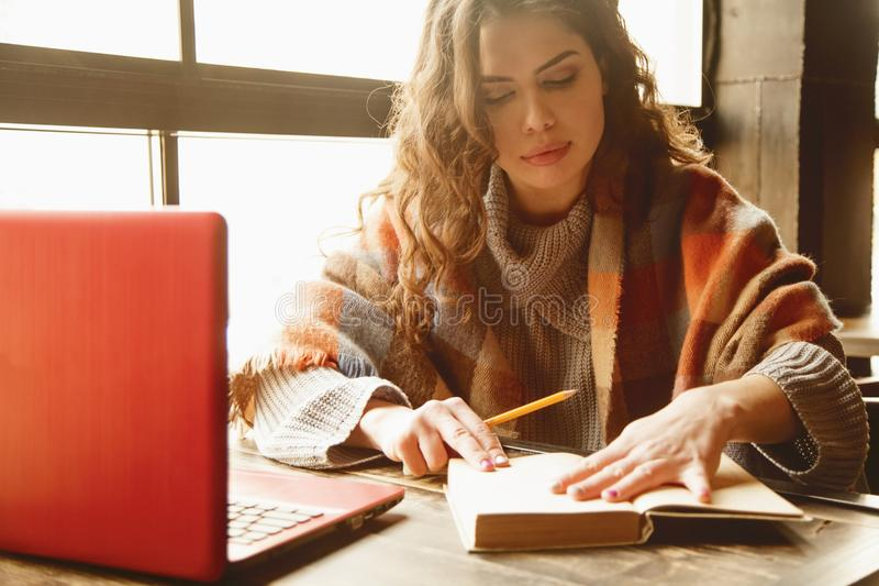 Successful Business Woman working in a cafe. Best places to work remotely in a city. Freelance, time management, freedom royalty free stock photos