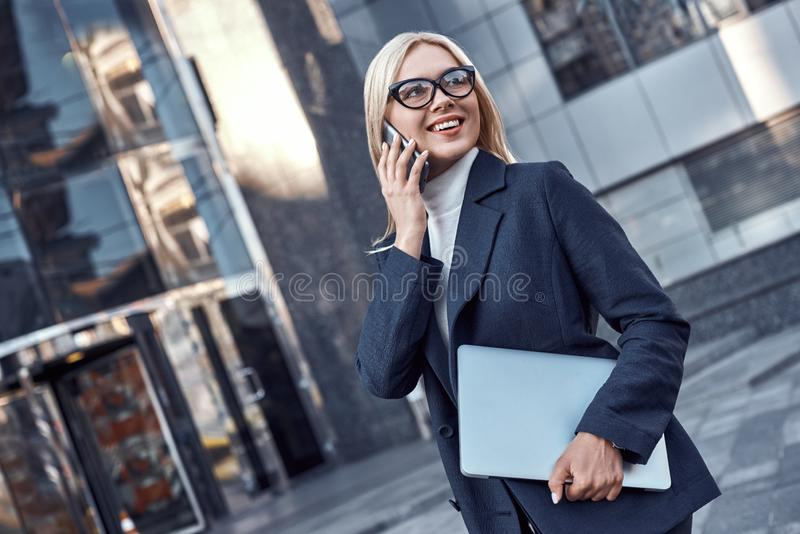 Successful business woman working at laptop in City royalty free stock photos
