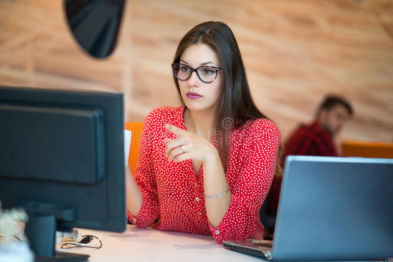 Successful business woman working at the office stock photo
