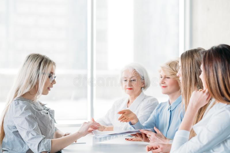 Successful business women female oriented company. Successful business women. Job interview at female oriented company. Qualification test. Ambitious candidate stock images