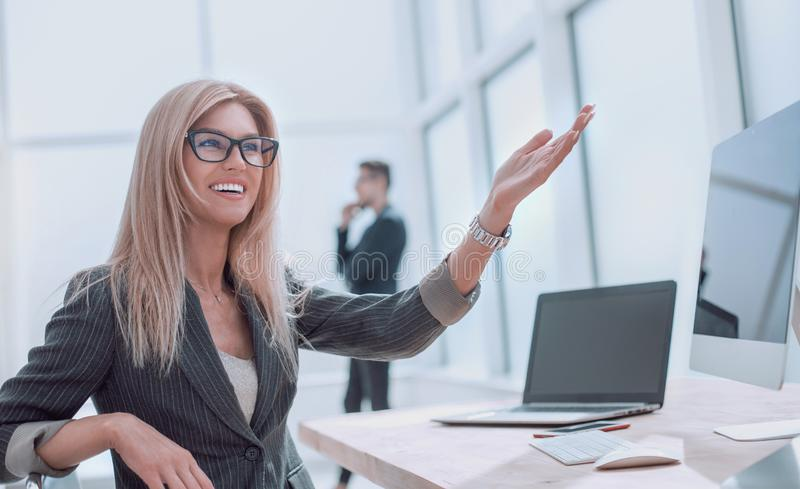 Successful business woman smiles at the client,sitting at the office table. Successful business women smiles at the client,sitting at the office table. photo stock photo