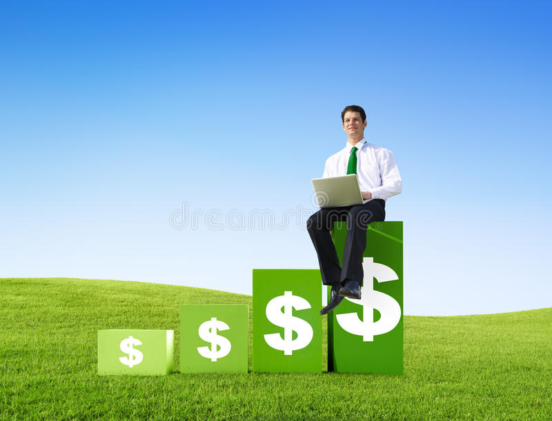 Successful Businessman on a Bar Graph stock photos