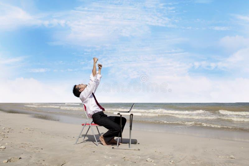 Successful businessman at beach