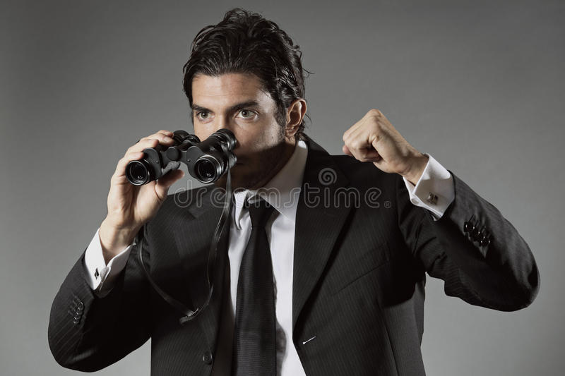 Successful businessman with binocular royalty free stock images