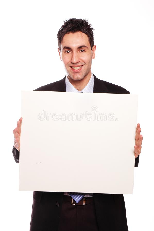Successful businessman and blank cardboard stock images