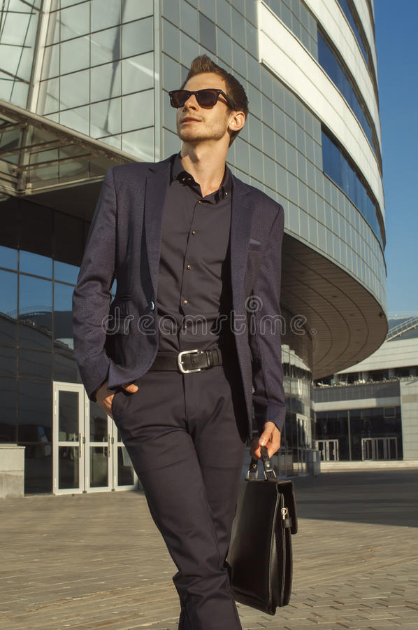 Successful businessman with briefcase in hand stock photo