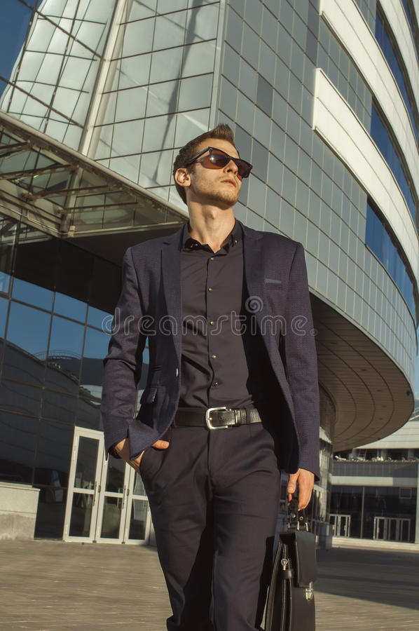 Successful businessman with briefcase in hand royalty free stock photos