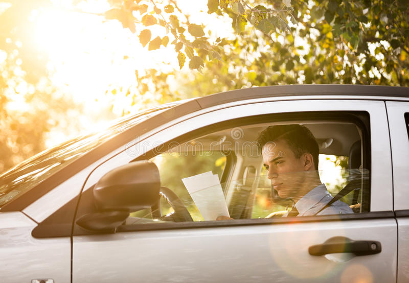 Successful businessman in the car stock photos