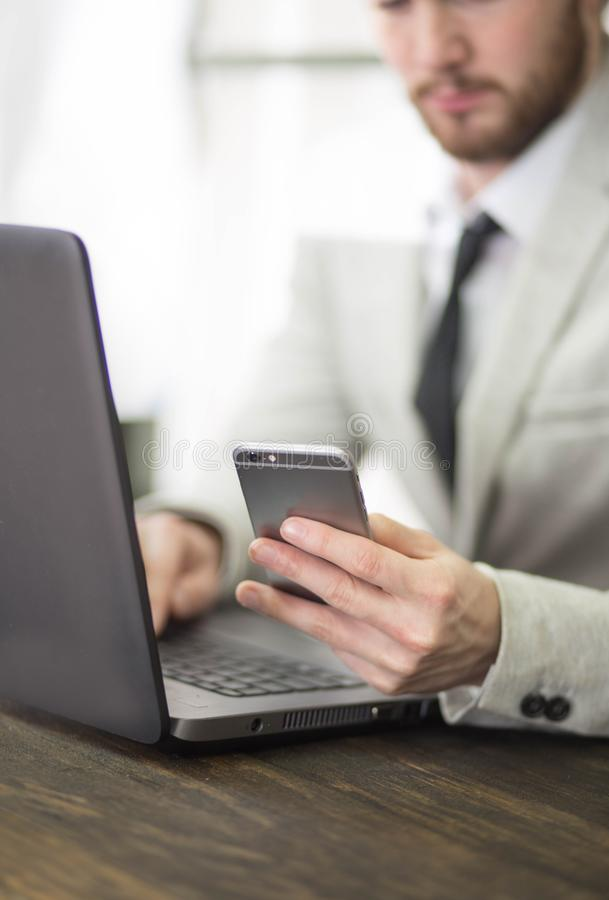 Successful businessman checking his bank account. On his cellphone royalty free stock photo