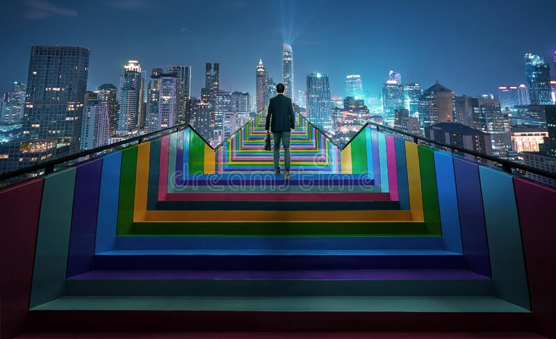 Successful businessman climbing on colorful stair. To beautiful night cityscape, ambitions concept . Photo manipulation royalty free stock photos