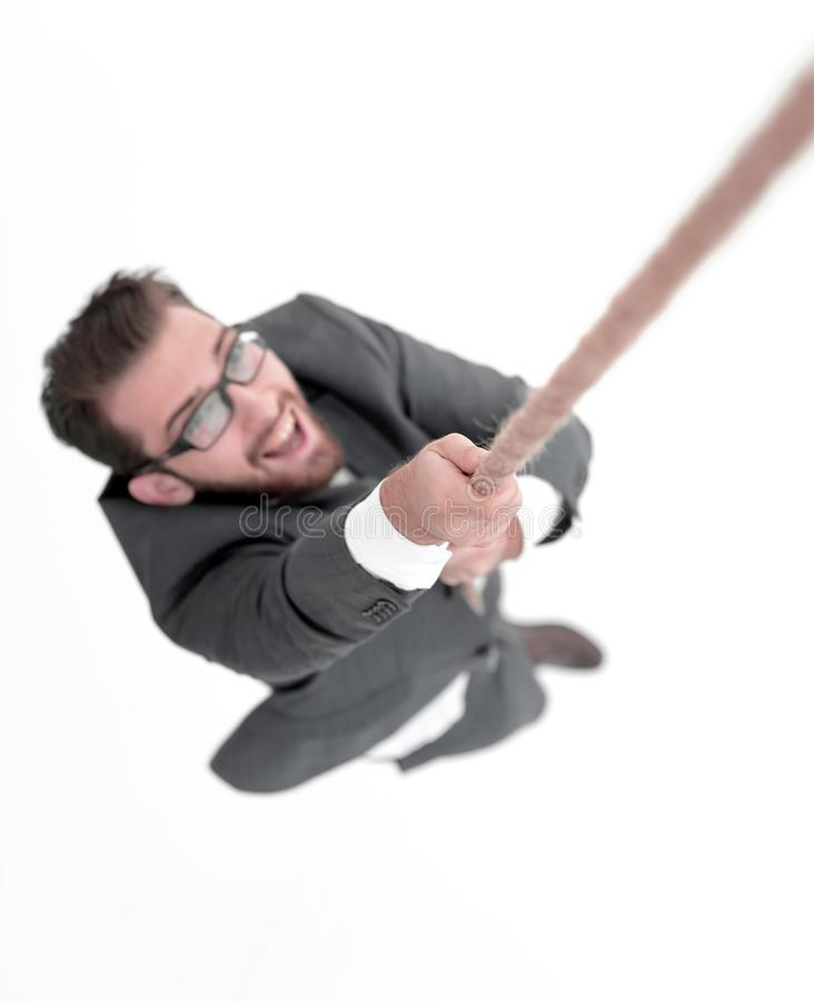 Successful businessman climbing the rope. Top view .a successful businessman climbing the rope.photo with copy space stock images