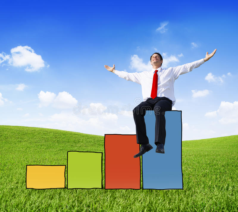 Successful Businessman on a Colorful Bar Graph stock photo