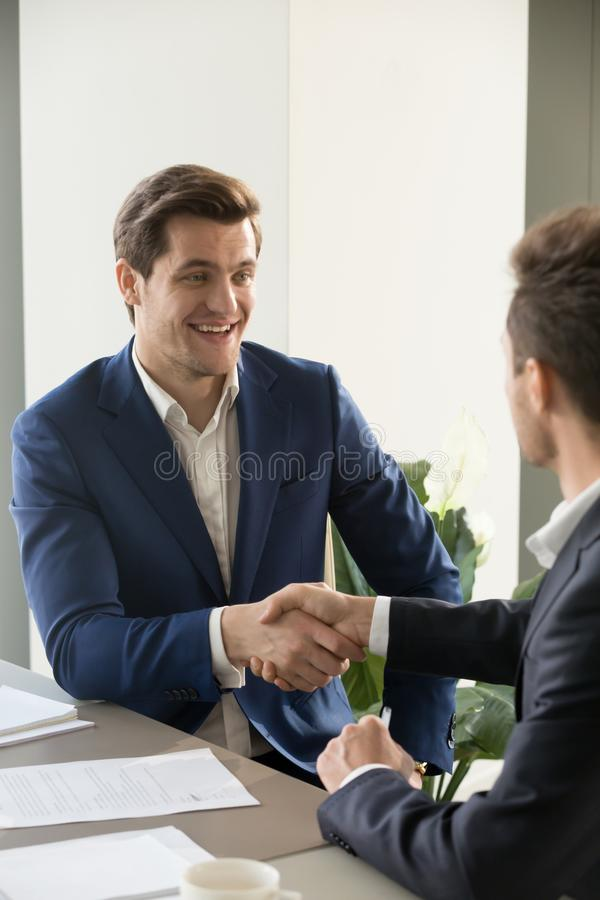 CEO congratulating new member of business team. Successful businessman congratulating partner with great deal, offering partnership, introducing himself during stock photos