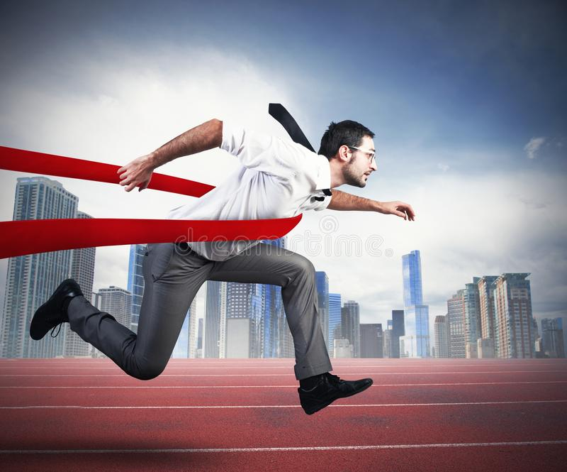 Successful businessman in a finishing line royalty free stock photo