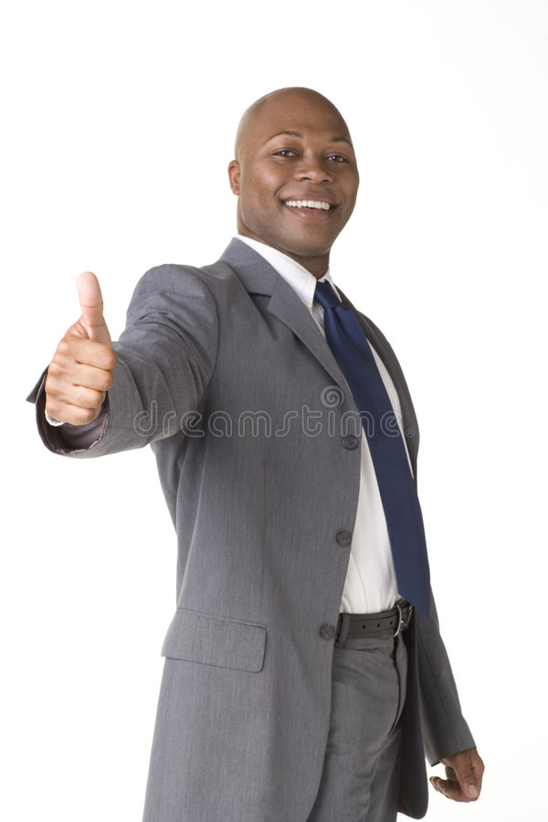 Successful Businessman giving the thumbs up sign royalty free stock image
