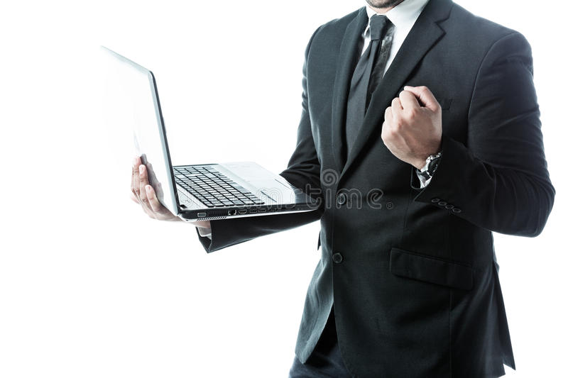 Successful businessman holding a laptop. Isolated on white royalty free stock image
