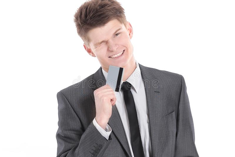 Successful businessman holding out a blank business card. royalty free stock image