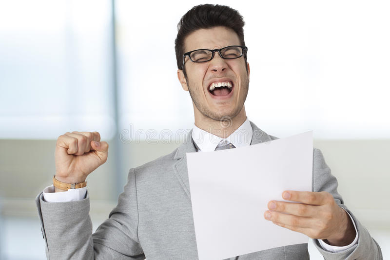 Successful businessman holding the paper stock photos