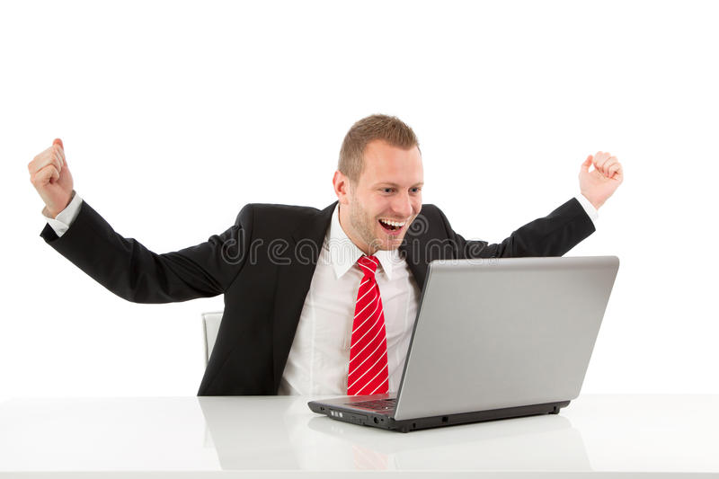 Successful businessman with laptop stock photo