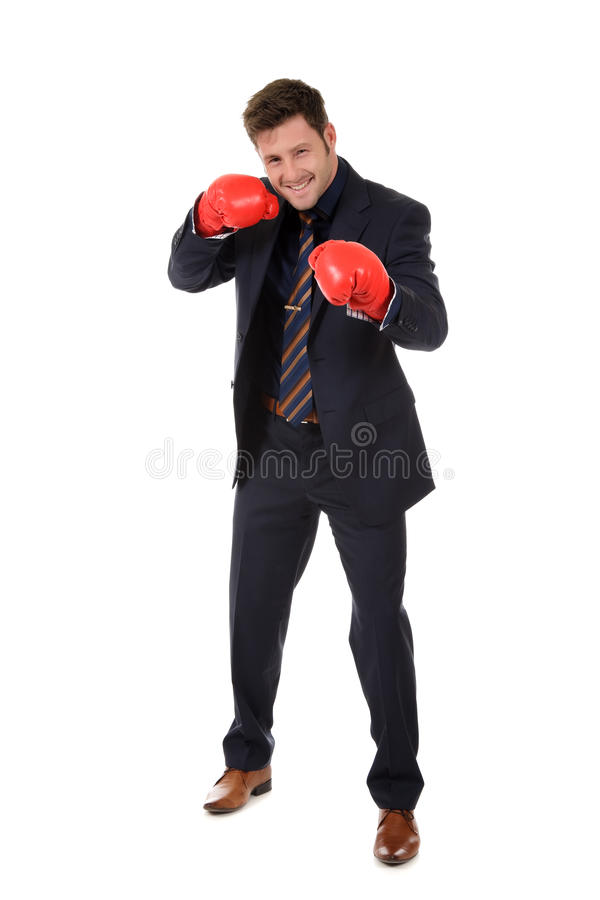 Successful businessman, left hand punch. Successful young caucasian businessman wearing boxing gloves. Left hand short punch. Studio shot. White background stock photo