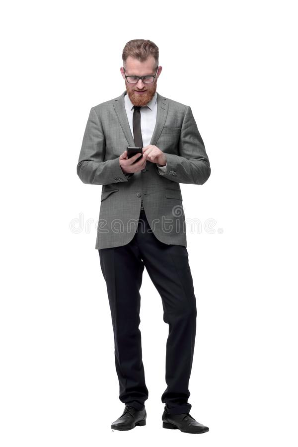 Successful businessman looking at the screen of his smartphone. royalty free stock image