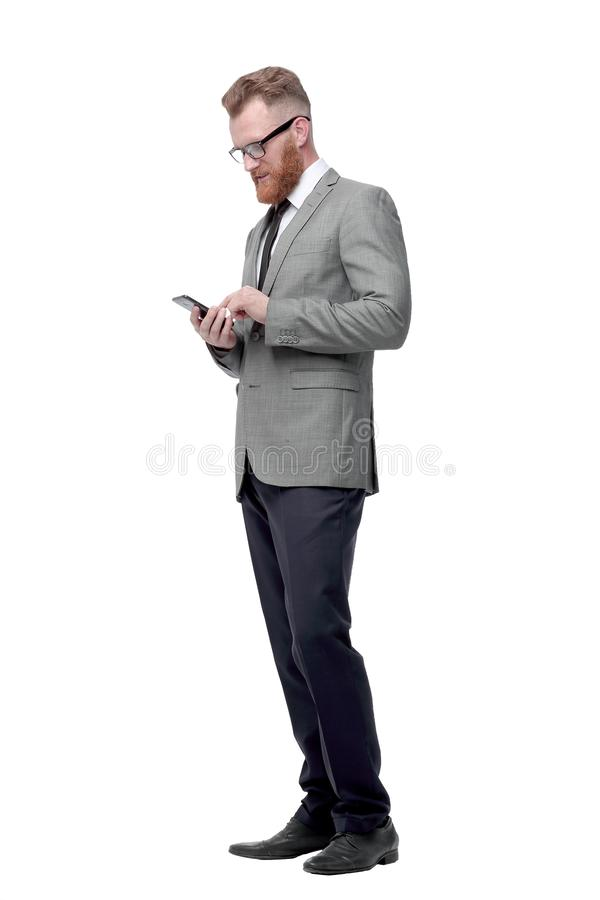 Successful businessman looking at the screen of his smartphone. stock image