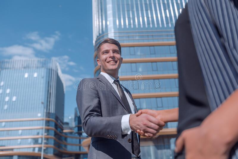 Successful businessman meeting a young employee with a handshake. royalty free stock photo