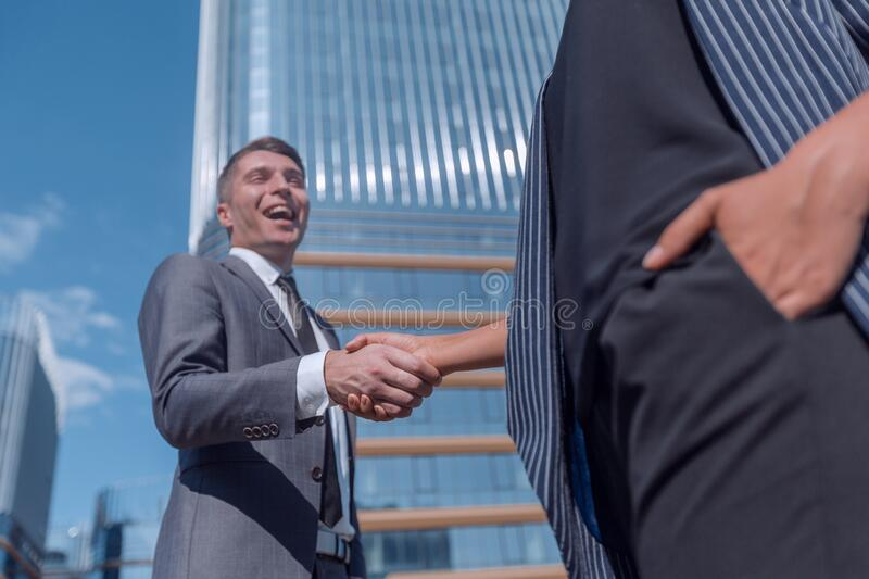 Successful businessman meeting a young employee with a handshake. royalty free stock image