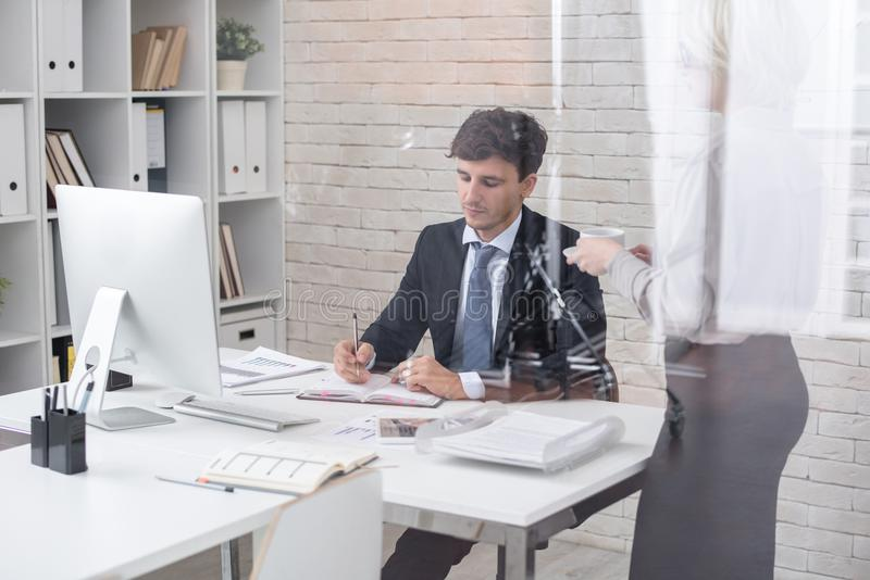 Successful Businessman in Office with Secretary royalty free stock image