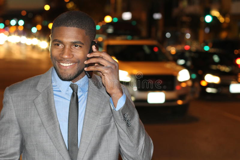Successful businessman on the phone in the city.  royalty free stock images