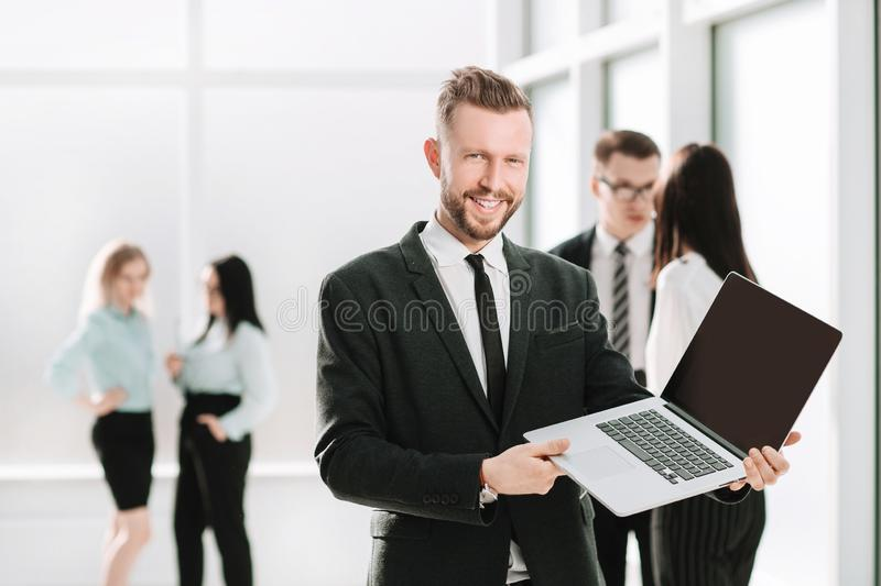 Successful businessman showing financial report on laptop screen. Photo with copy space royalty free stock photography