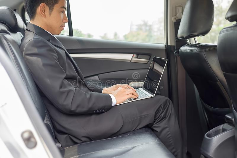 Successful businessman sitting in the back seat royalty free stock photography