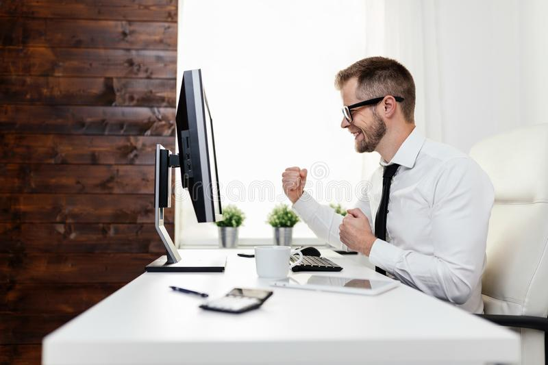 Successful businessman sitting in his office stock image