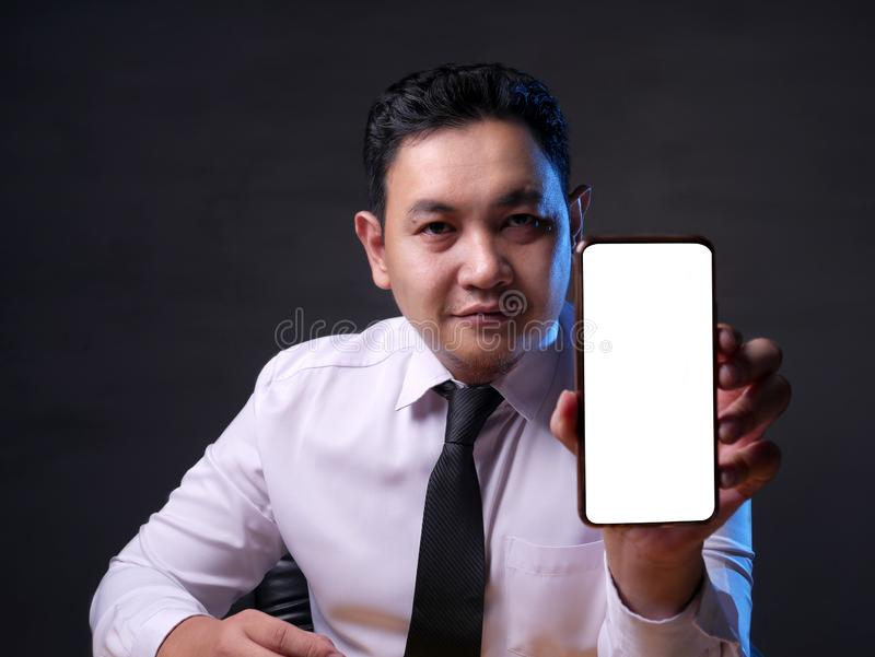 Successful Businessman with Smart Phone Mockup stock image