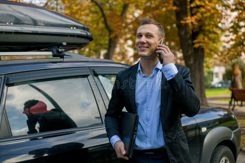 Successful businessman in suit with laptop in the city stock photo