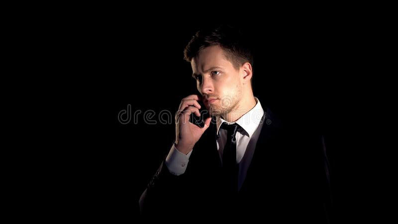 Successful businessman talking phone, making important deal, partnership stock image