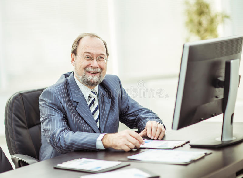 Successful businessman working with financial charts at the workplace in the office royalty free stock image
