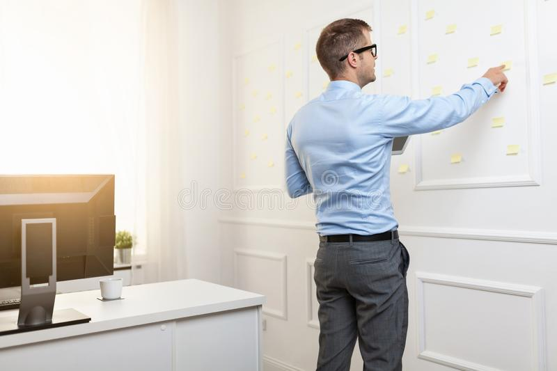 Successful businessman working in his office stock photo