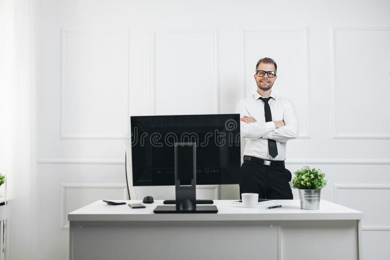 Successful businessman working in his office stock photos