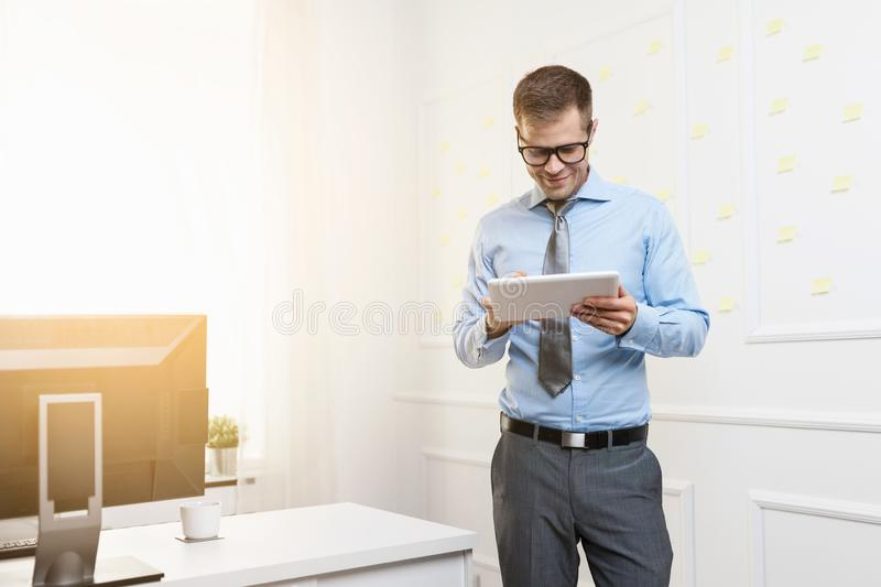 Successful businessman working in his office stock images