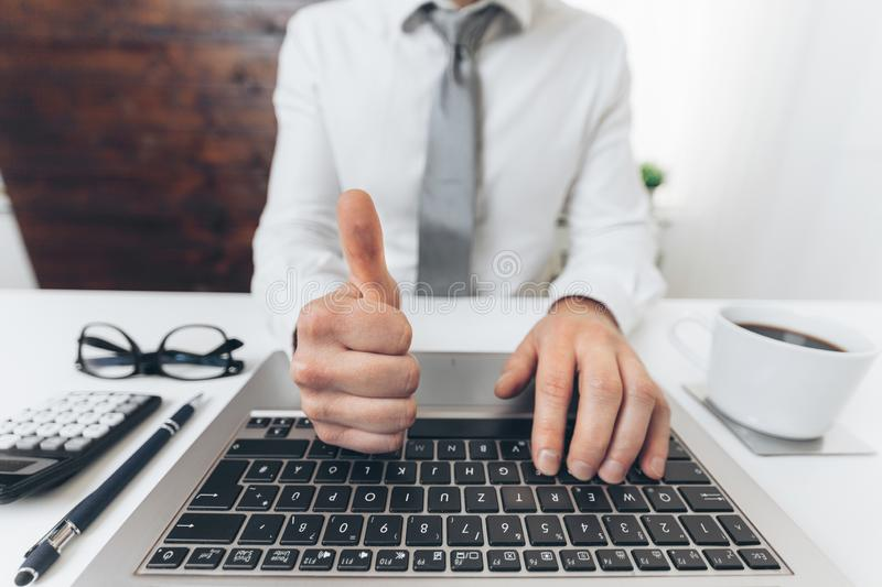 Successful businessman working in his office stock photography